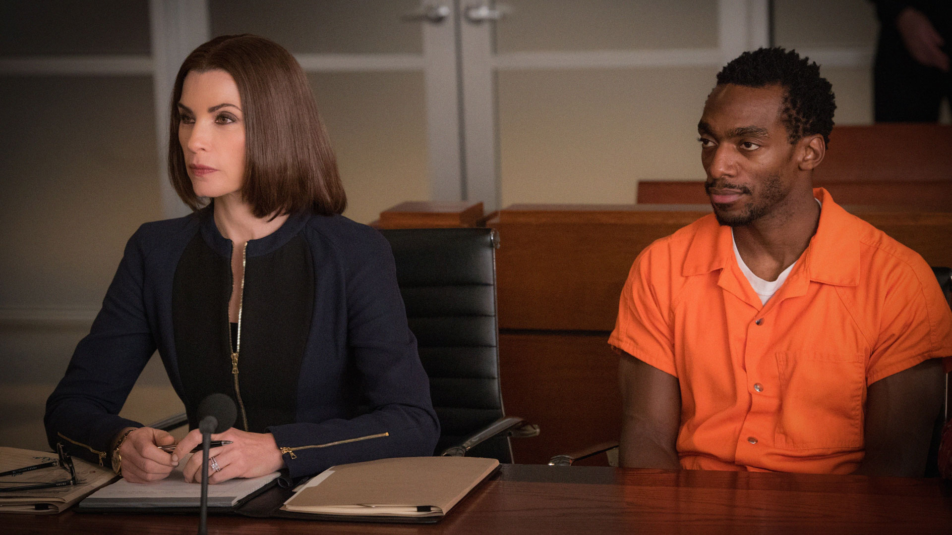 Julianna Margulies as Alicia Florrick and Daniel J. Watts as Clayton Riggs