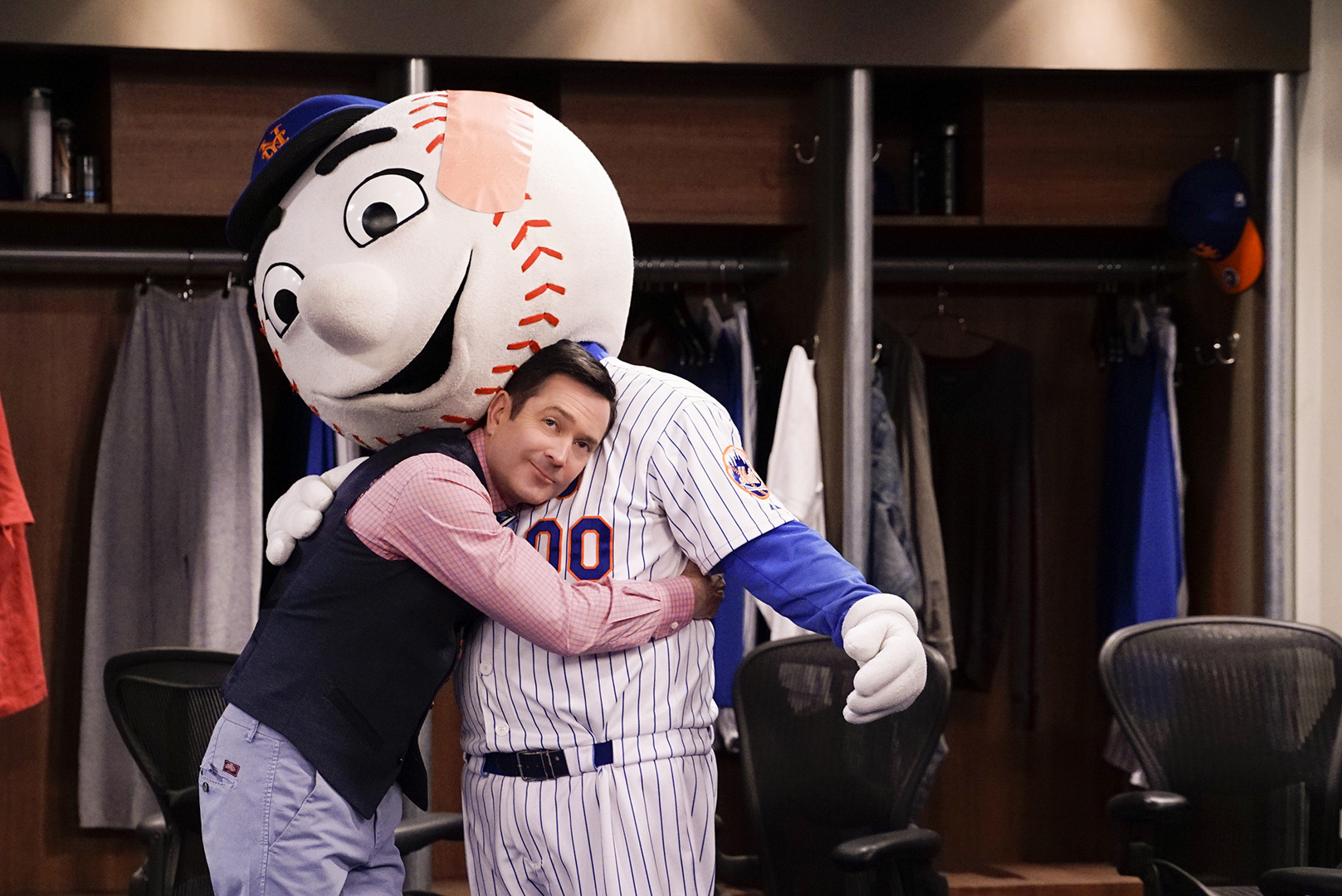 Felix gives Mr. Met a big hug.