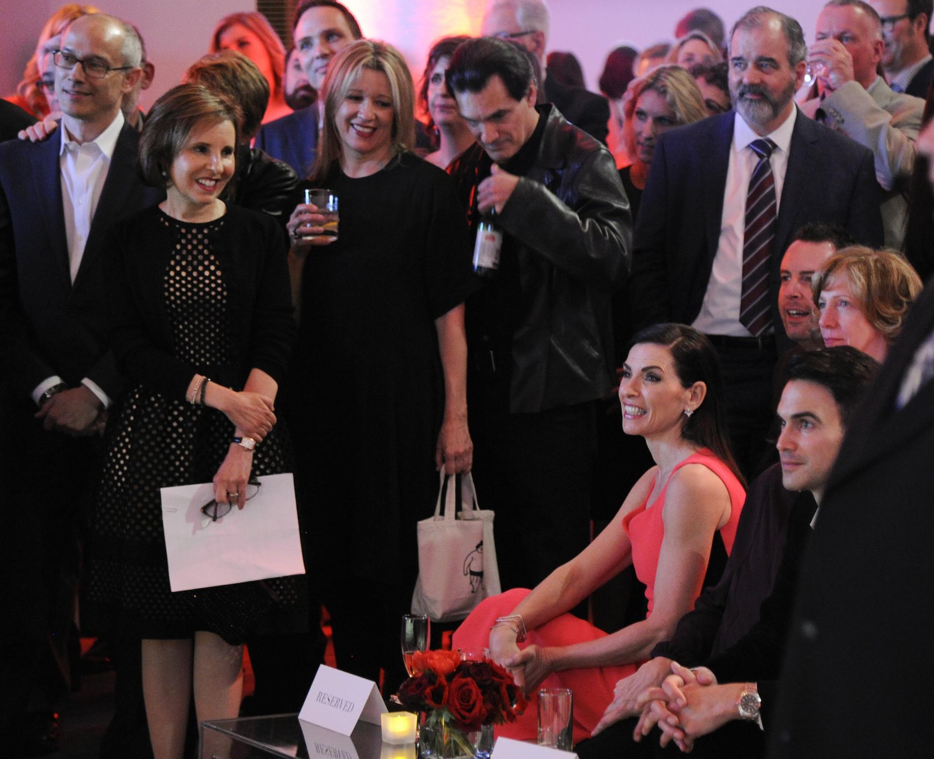 The cast and crew enjoy a touching speech