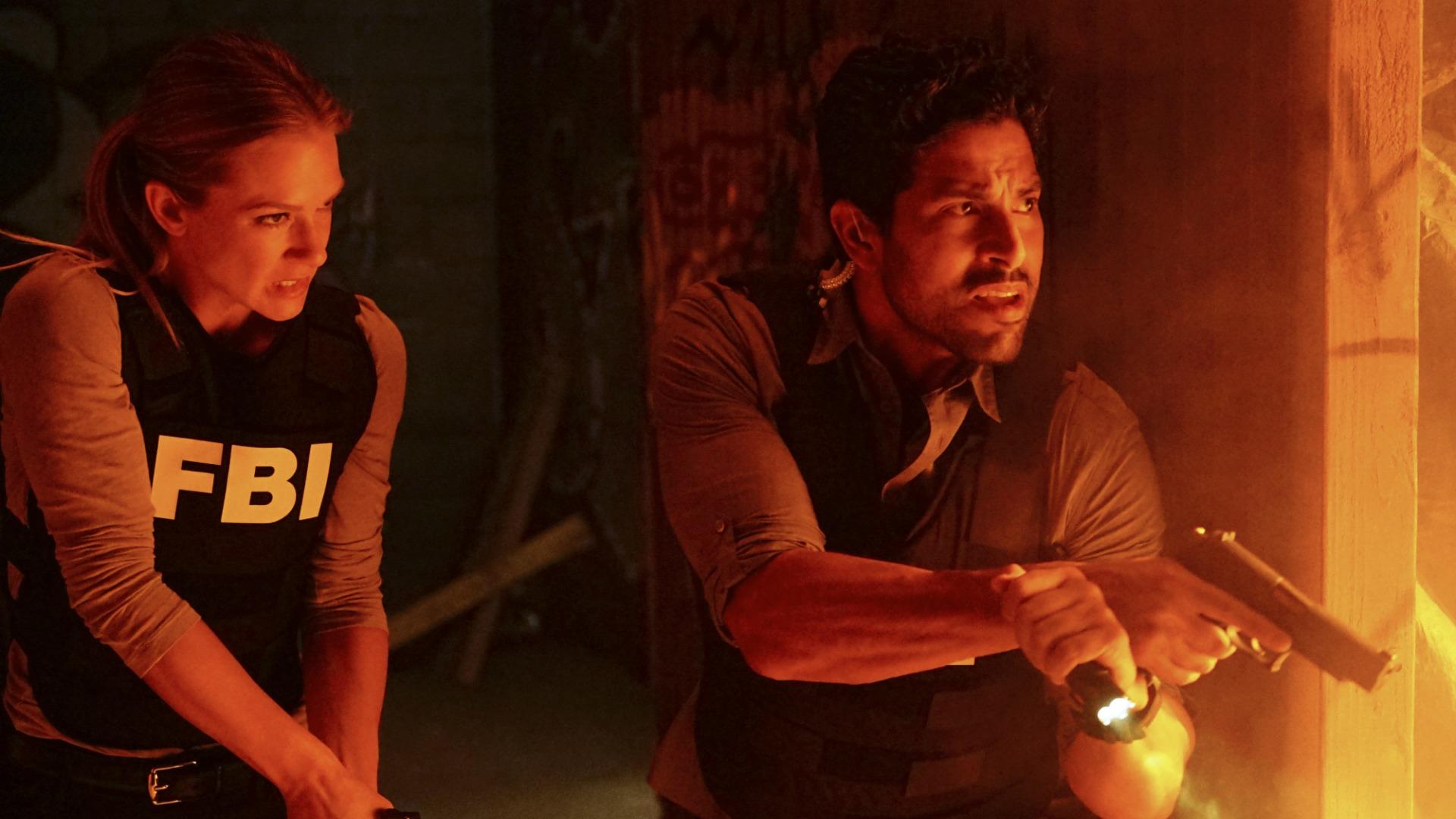 JJ and Agent Alvez prepare to enter a burning building.