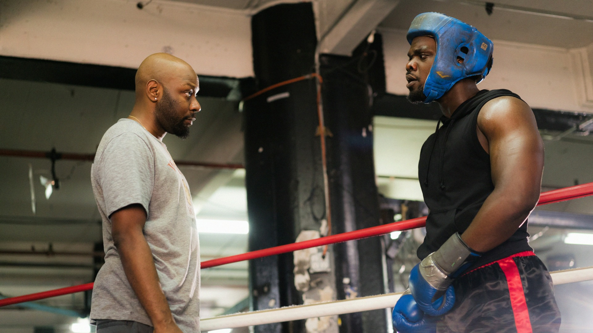 Shinwell speaks to a boxer in the ring.