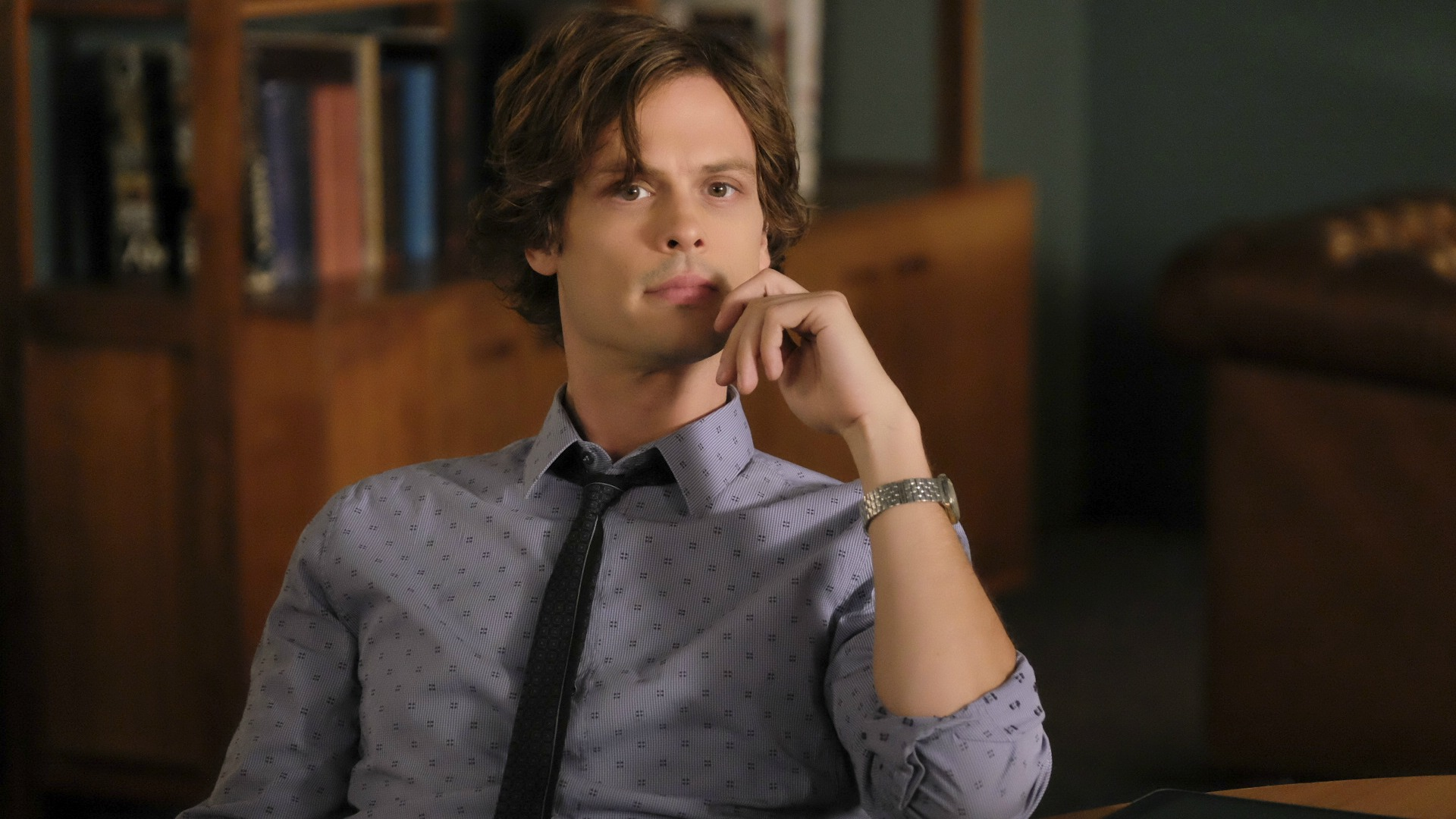 Dr. Spencer Reid is deep in thought.