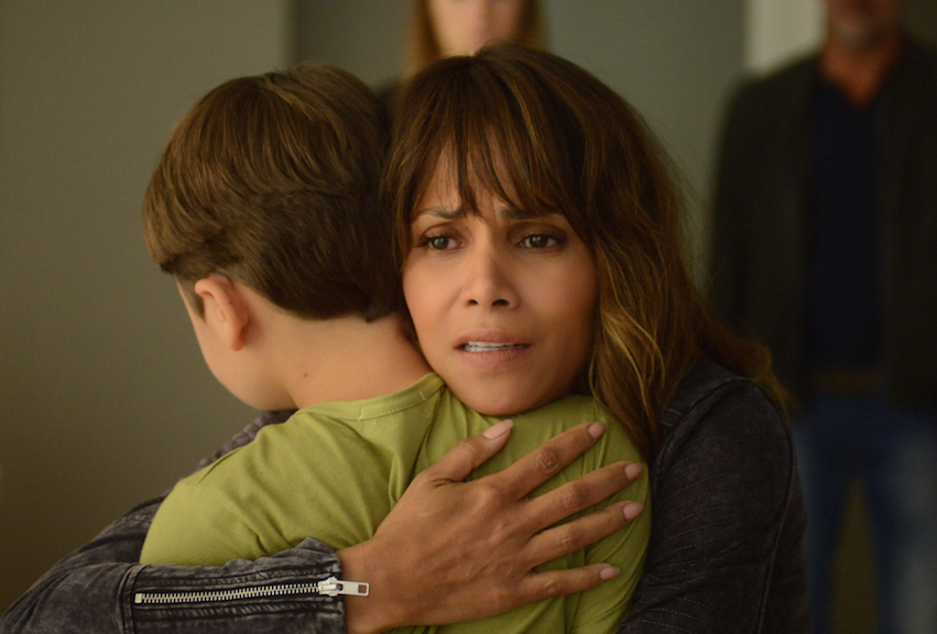 Pierce Gagnon as Ethan Woods and Halle Berry as Molly Woods.