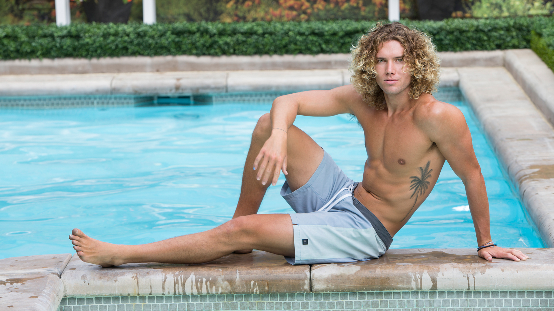 Tyler Crispen relaxes poolside and shows off his summery tattoo.
