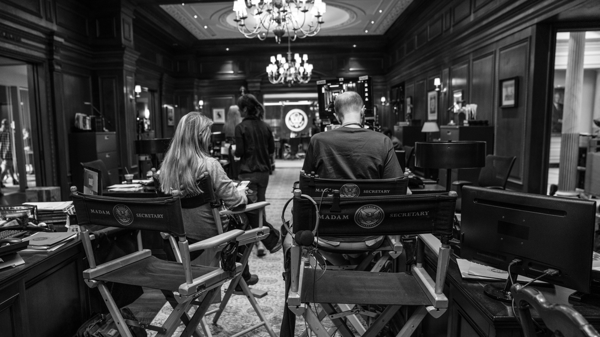 The Madam Secretary crew is hard at work in this black-and-white shot.