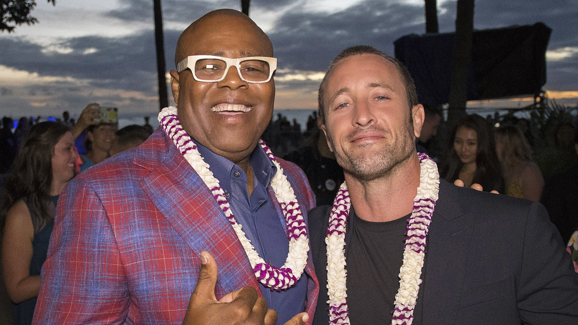 Chi McBride and Alex O'Loughlin pose together in their matching leis.