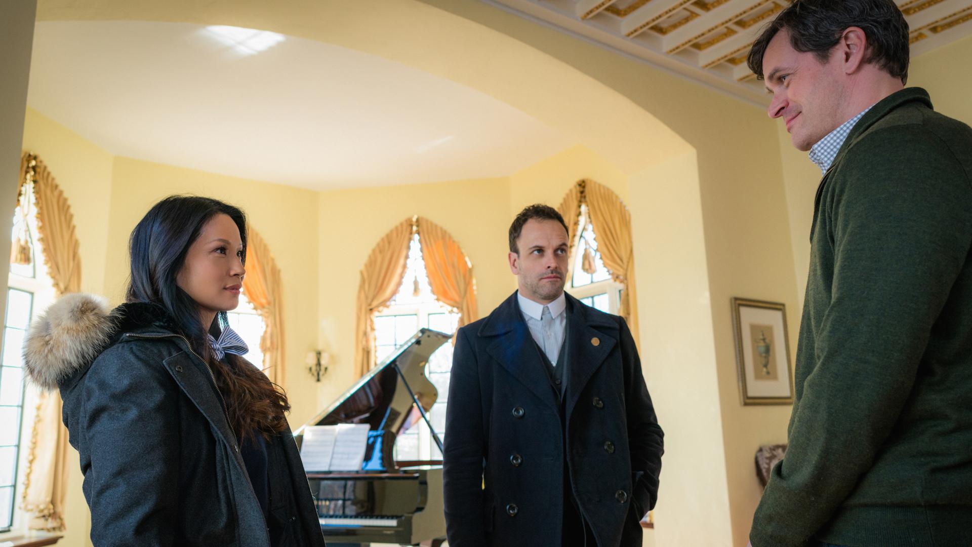 Lucy Liu as Joan Watson, Jonny Lee Miller as Sherlock Holmes, and Tom Everett Scott as Henry Baskerville