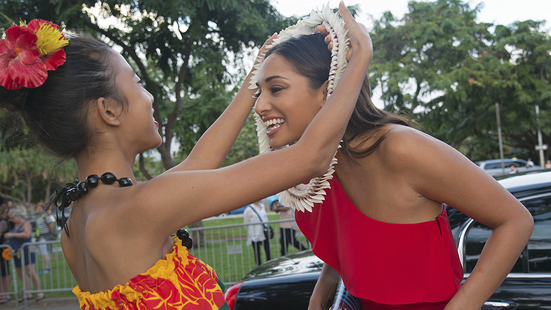 Meaghan Rath receives a lei before entering the celebration.