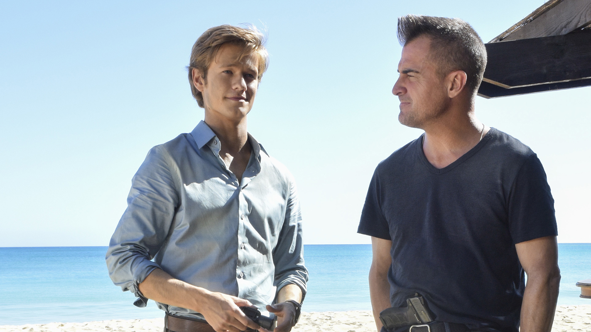Mac and Jack have a chat on the beach.
