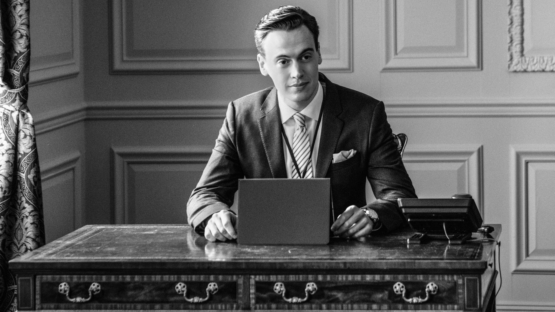 This sophisticated snapshot shows Erich Bergen as Blake Moran in black and white.