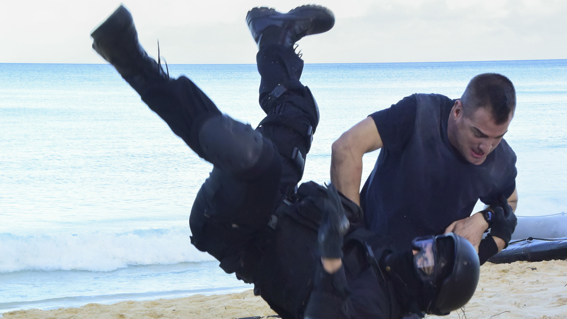 Jack uses his famous takedown moves on the beach.