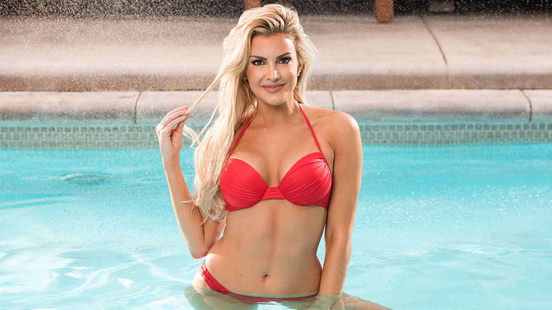 Kathryn Dunn looks to make waves in and out of the pool in her beach-ready swimwear.