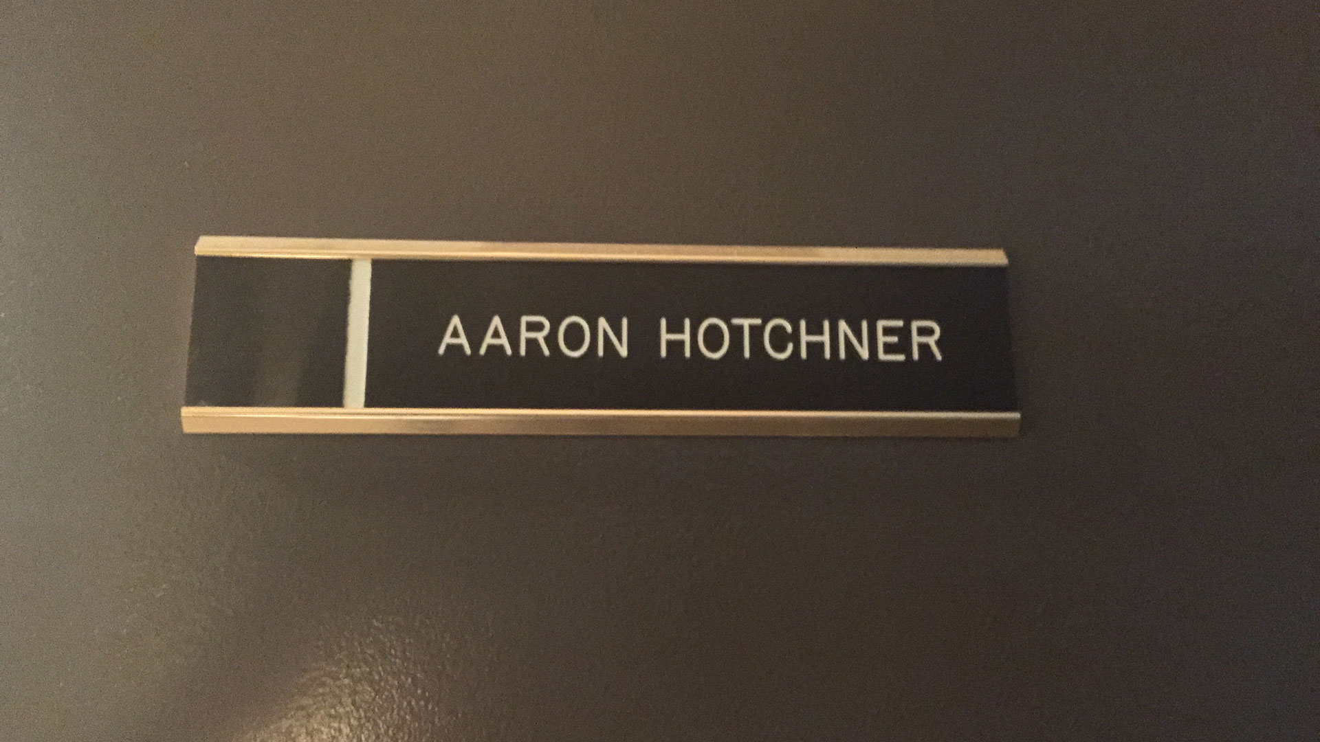 A closeup of SSA Aaron Hotchner's office door
