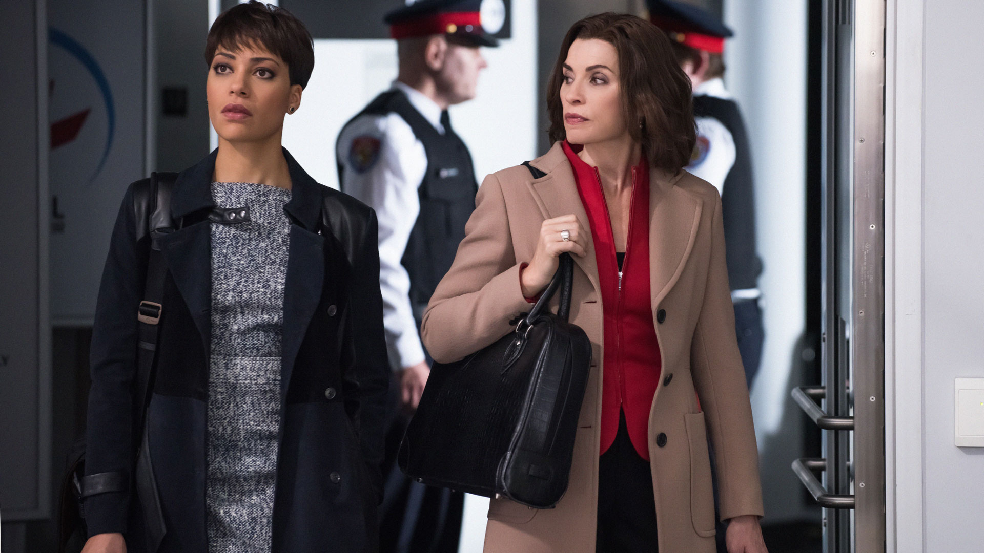 Lucca Quinn and Alicia Florrick arrive at the airport.