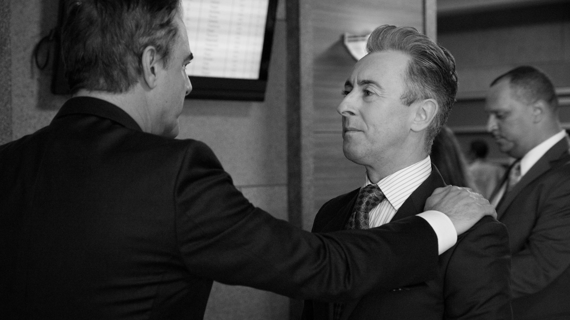 Chris Noth and Alan Cumming share a moment.