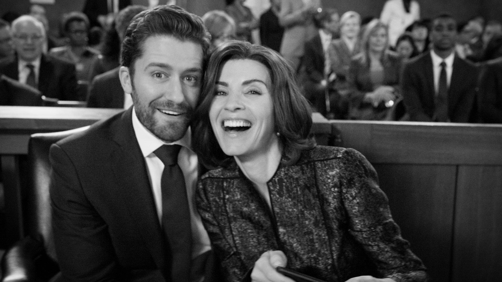 Matthew Morrison and Julianna Margulies smile on set.