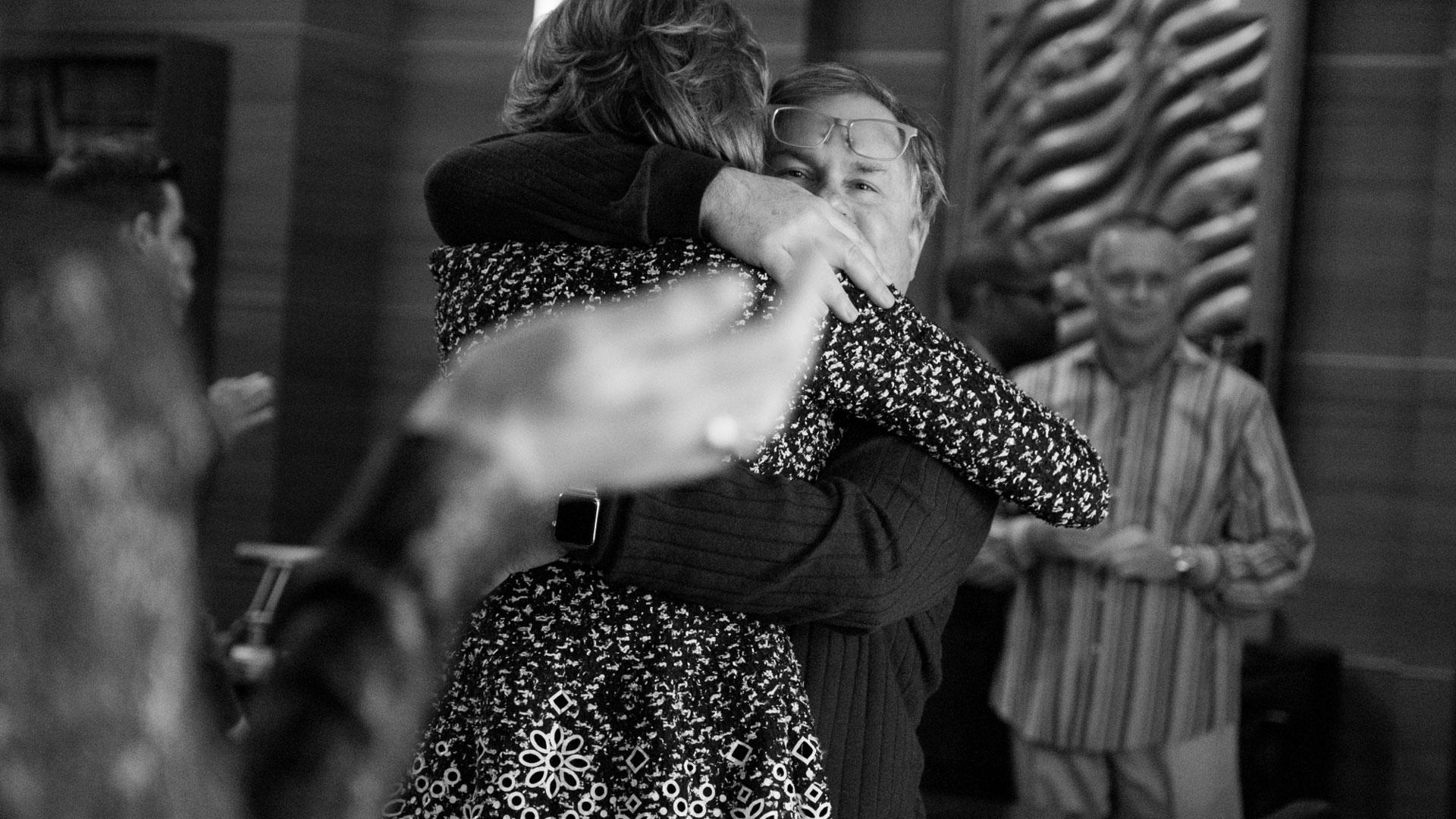 Christine Baranski and Robert King hug on set.