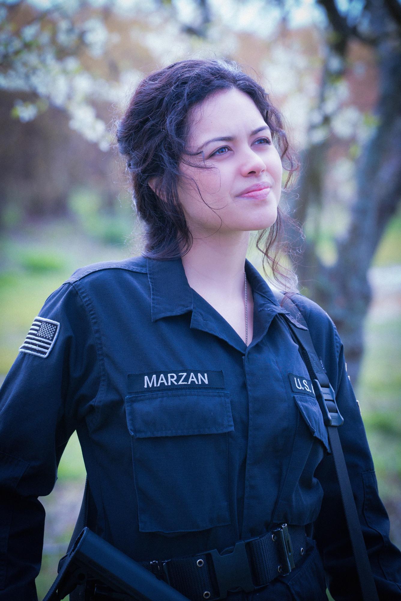 Dariela Marzan assesses the team's surroundings.
