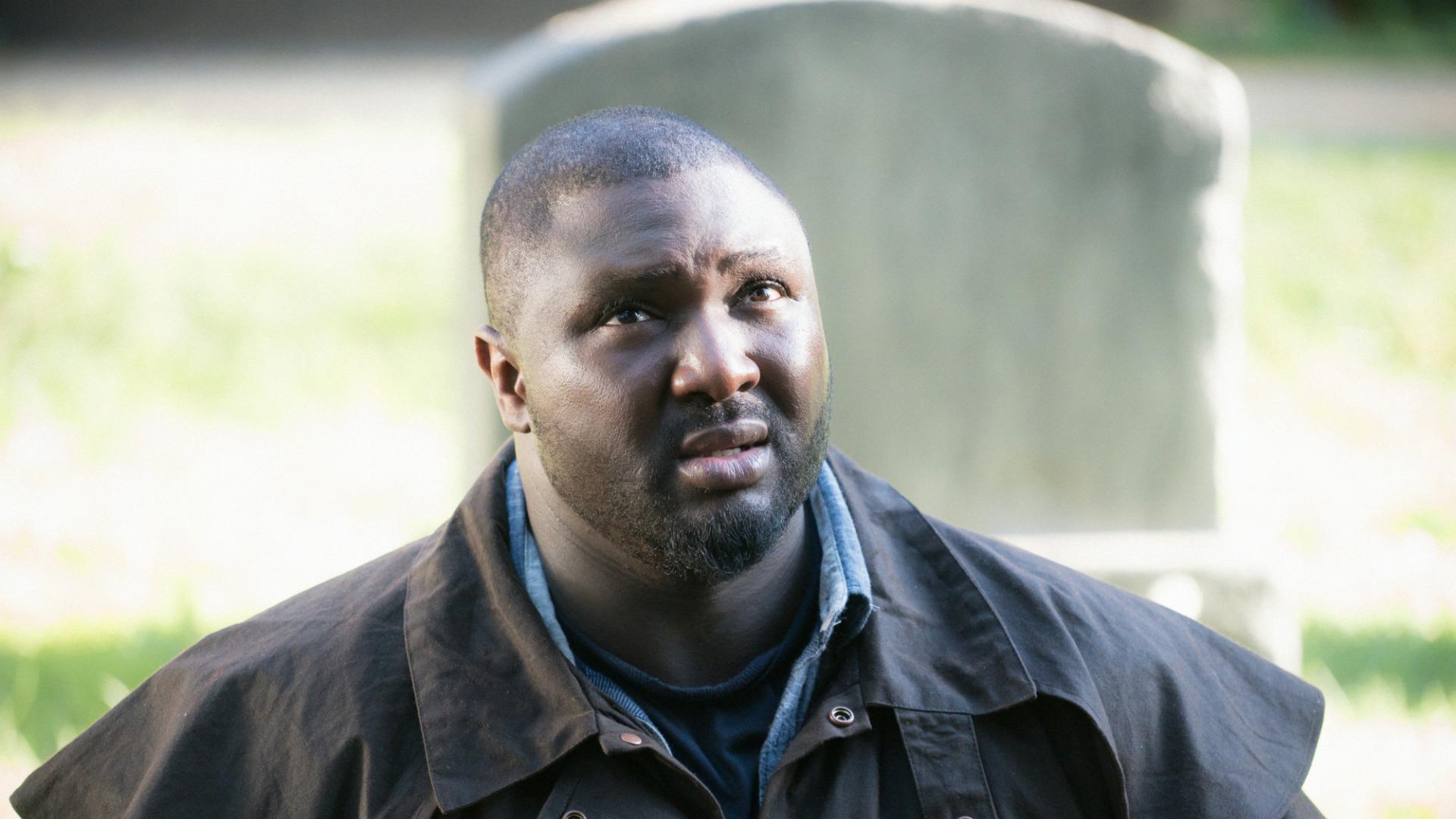 Abraham Kenyatta asks questions in a graveyard.