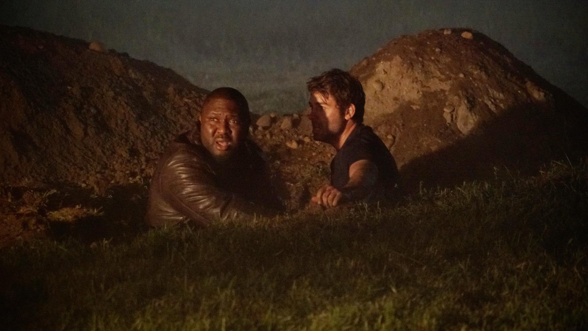 Abraham and Jackson start digging.